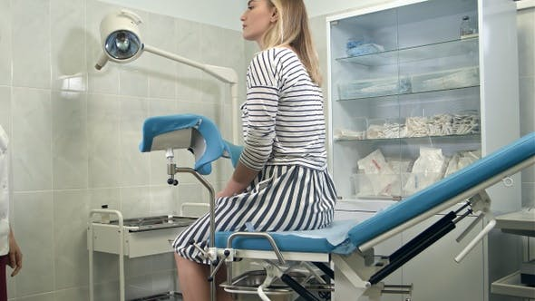 Thumbnail for Gynecologist asking female patient to sit on gynecological