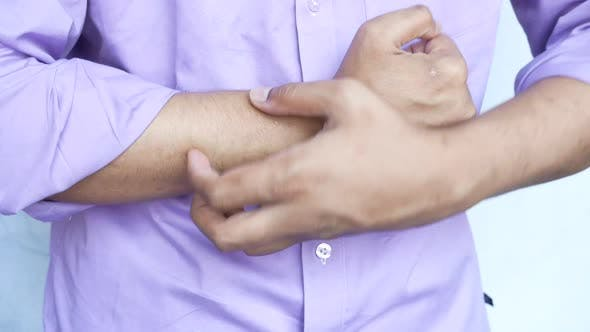 Man Suffering From Itching Skin Close Up