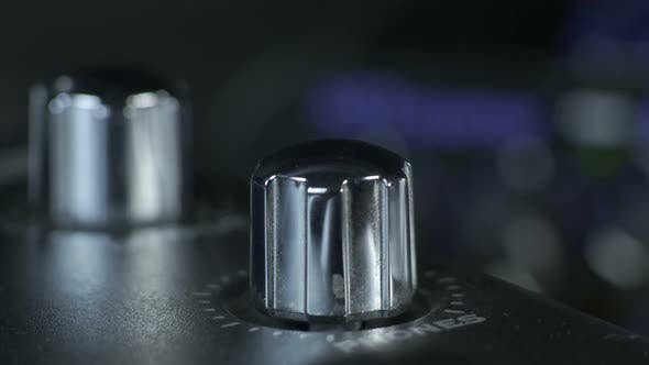 Thumbnail for Female Fingers Turning Silver Audio Interface Knob