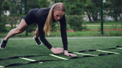 Woman Training Speed Ladder Drills