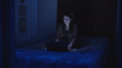 Woman enjoying music video at night