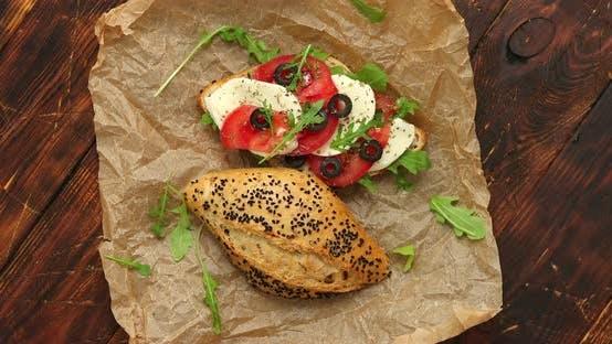 Delicious Fresh Bruschetta with Tomato, Basil, Black Olives and Mozarella Cheese
