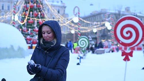 Young Woman Sculpts Snow