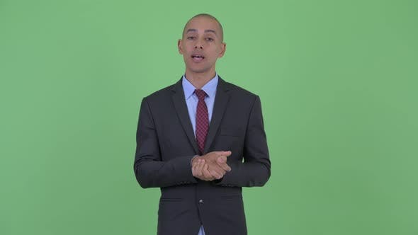 Thumbnail for Happy Bald Multi Ethnic Businessman Explaining Something