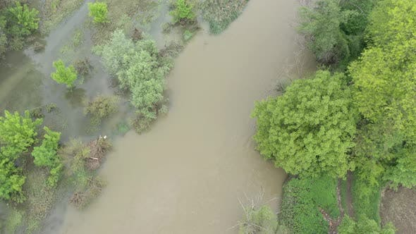 Thumbnail for Flooded coastal area of narrow river 4K aerial footage