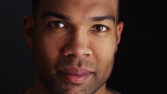 Thumbnail for Headshot of black man looking at camera