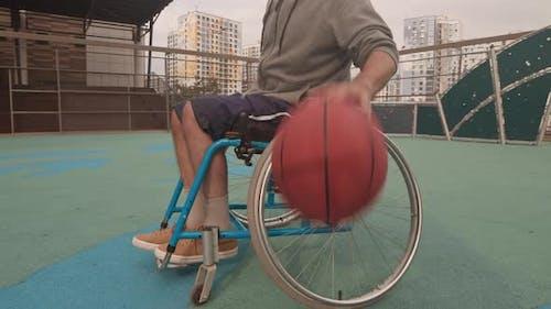 Athlete in Wheelchair Dribbling