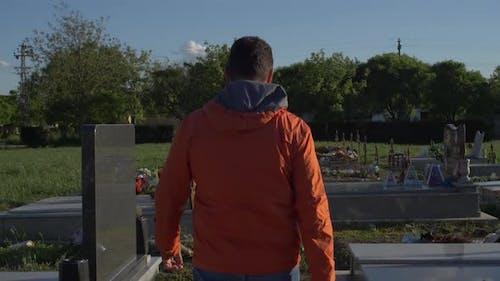 A Man At Graveyard