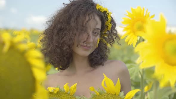 Thumbnail for Portrait of Confident Beautiful Curly Girl Looking at the Camera Smiling Standing in the Sunflower