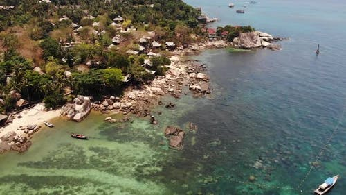 Small Houses on Tropical Island. Tiny Cozy Bungalows Located on Shore of Koh Tao Island