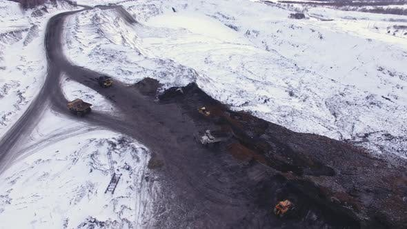 Coal Mine, Dump Trucks Carry Rock and Coal