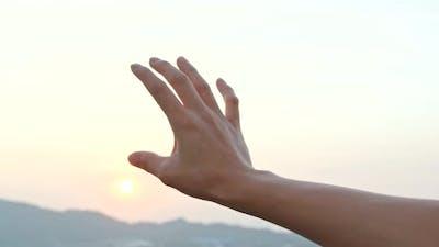 Hand to sun