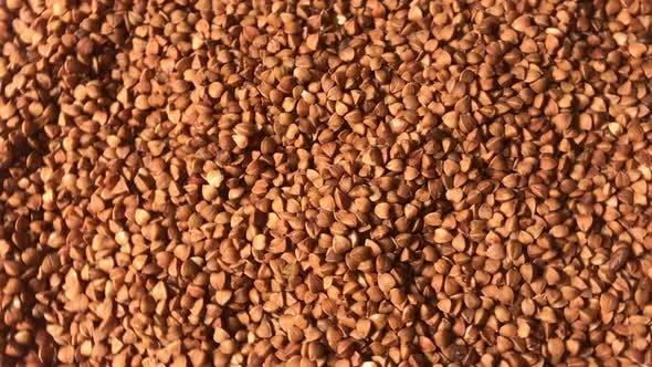 Buckwheat background. Useful properties of buckwheat.