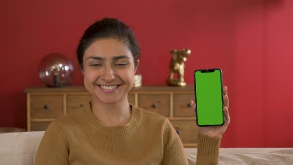 Young Indian Woman Holding Smartphone Shows New App, Green Screen Technology