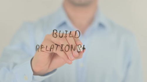 Build Relationship, Man Writing on Transparent Screen