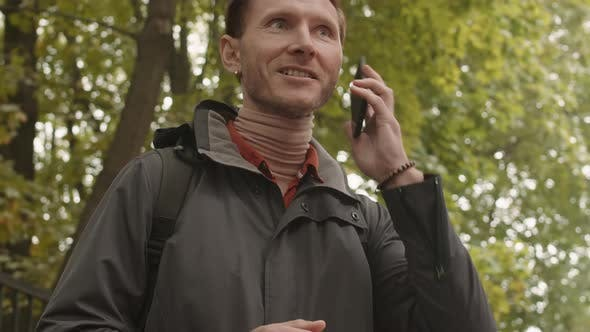 Thumbnail for Man Talking on Phone Outdoors