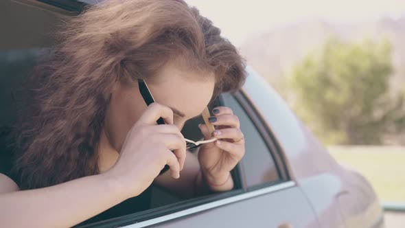 Thumbnail for Positive Woman Puts on Sunglasses and Fixes Hair Inside Car
