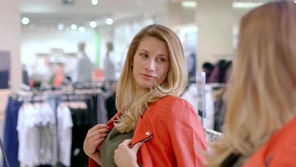 Woman Trying on Leather Jacket