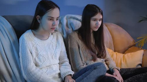 Two Girls Watching Scary or Bad TV Show and Feeling Disgusting