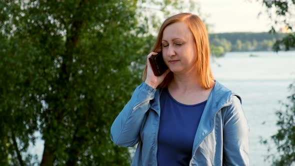 Thumbnail for Middle-aged Woman Talking on the Phone