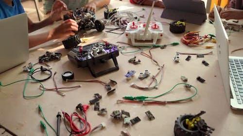Group of Multiethnic Schoolkids in Classroom Building Robot