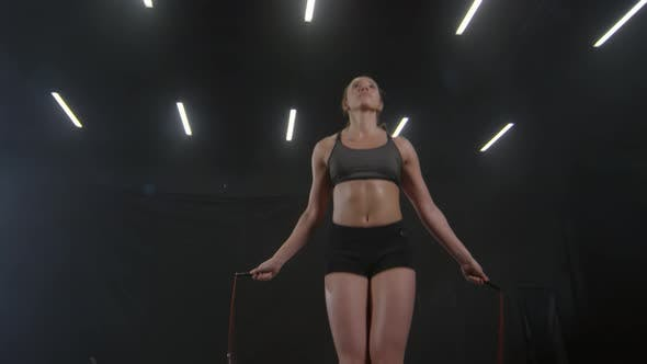 Thumbnail for Woman Jumping with Rope during Cardio Workout