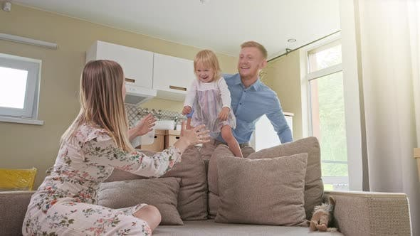 Active Family Group Move in Rent Real Estate. Positive Looking at Relocating or Unpacking of Carton