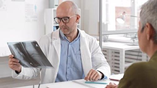 Doctor Checking Leg X-rays