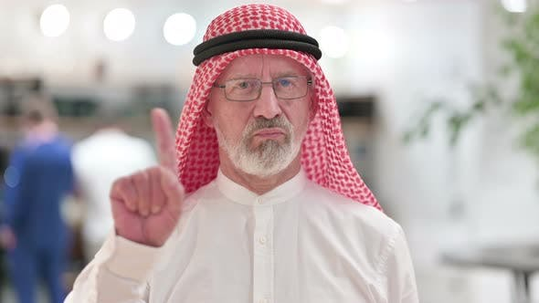 Thumbnail for Senior Old Arab Businessman Saying No By Finger Sign