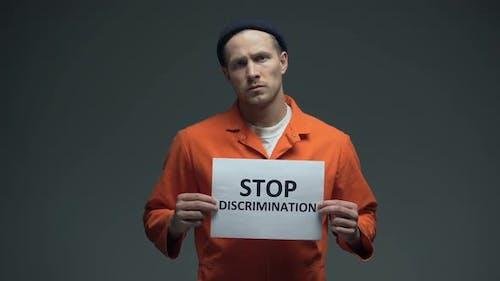 Caucasian Imprisoned Man Holding Stop Discrimination Sign, Racial Prejudice