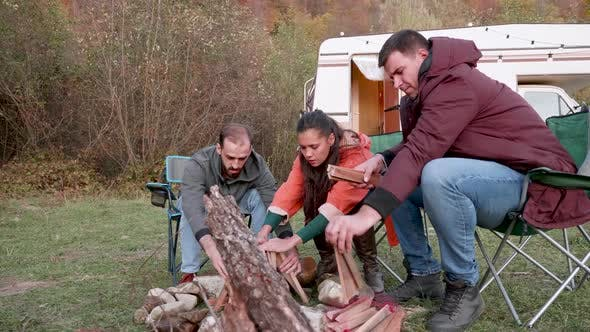 Cover Image for Couple and Their Close Friend Preparing Camp Fire
