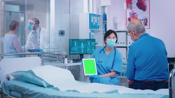Thumbnail for Presenting Green Screen Tablet To Patient