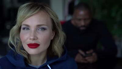 Portrait of a Middleaged Blonde with Red Lipstick on Lips