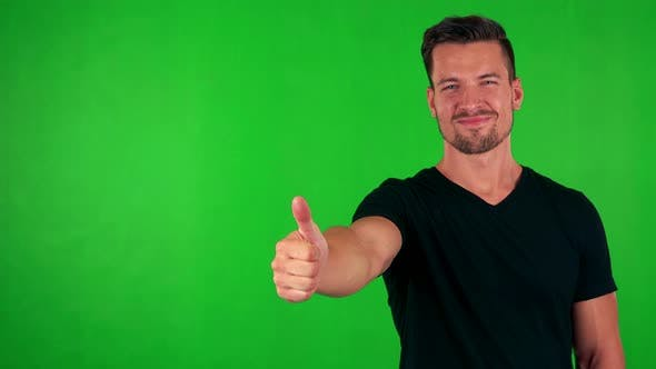 Thumbnail for Young Handsome Caucasian Man Shows Thumb Up on Agreement - Green Screen - Studio