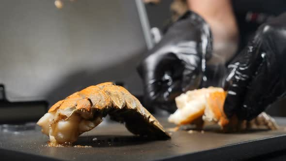 Close-up Shot of Chef Cooking Bbq Seafood. Delicious Grilled Lobster Tails Being Cooked on Grill