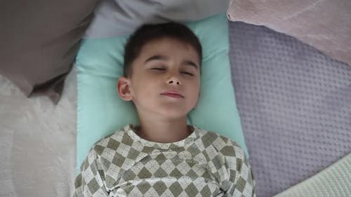 A Little Boy Wakes Up in the Morning Having a Good Mood