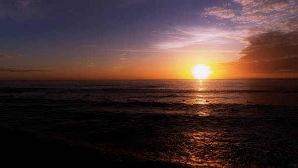 Thumbnail for Surfers at Sunset