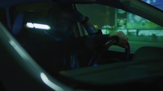 Thumbnail for Sleepy Man Driving at Night