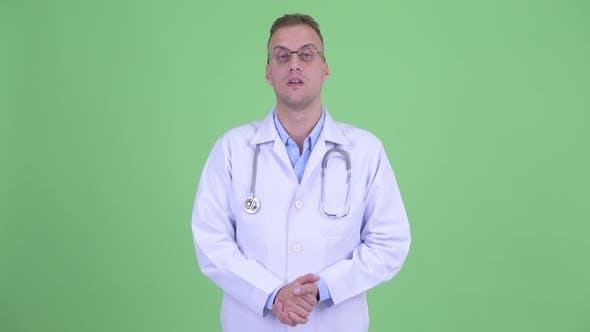 Thumbnail for Happy Handsome Man Doctor Explaining Something