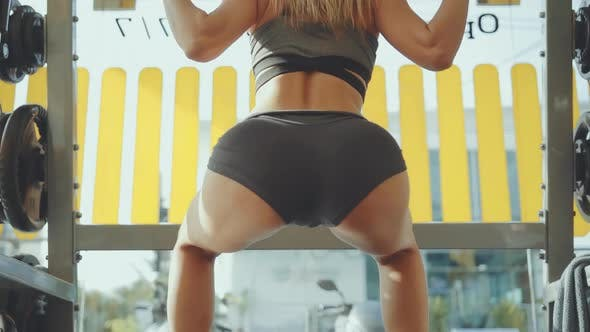 Thumbnail for Sexy Sporty Woman Doing Squats at Gym