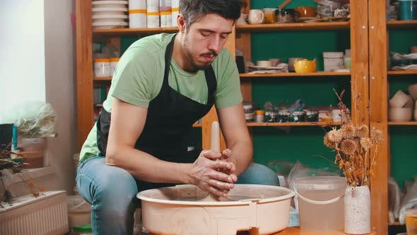 Thumbnail for Pottery - Potter Master Is Pulling Clay in Length on a Potter's Wheel