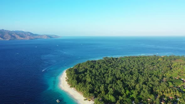 Wide angle drone island view of a white sand paradise beach and blue sea background in hi res 4K