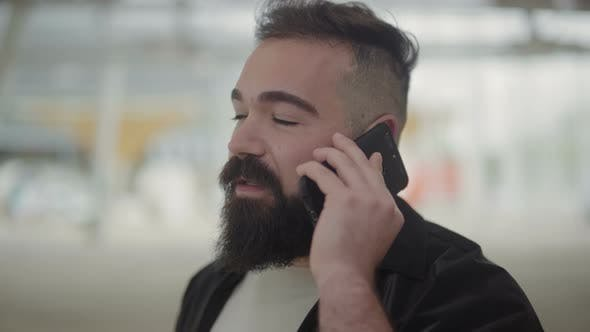Thumbnail for Calm Bearded Man Talking on Phone