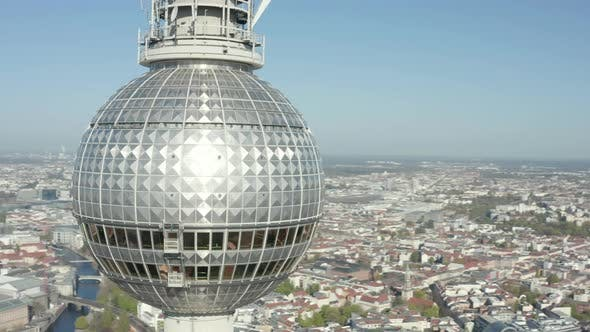 Thumbnail for AERIAL: Super Close Up View Circle Around the Alexanderplatz TV Tower in Berlin, Germany