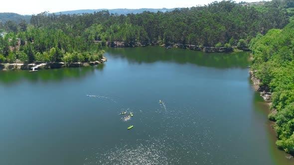 Thumbnail for Kayaking Athletes Paddling Canoes