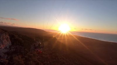 Free Paragliding Flying at Sunset in Ocean Coast Mountains in Morocco Adrenaline Adventure
