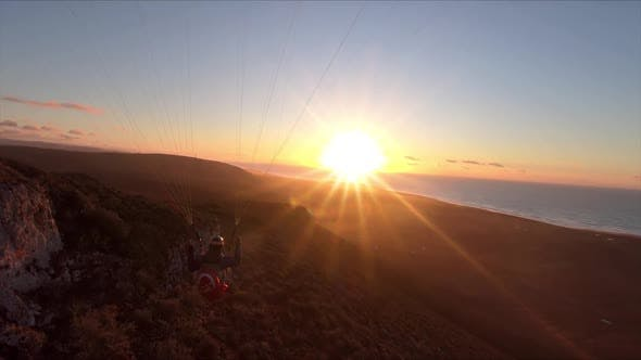 Thumbnail for Free Paragliding Flying at Sunset in Ocean Coast Mountains in Morocco Adrenaline Adventure