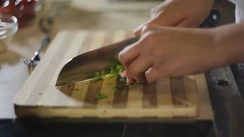 Woman Hands Chopping Green Vegetable Salad on Cutting Board, Vegetarian Food