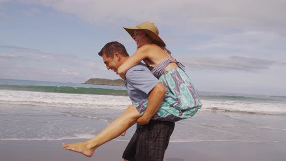 Thumbnail for Playful couple at beach having fun, Costa Rica. Shot on RED EPIC for high quality 4K, UHD, Ultra HD