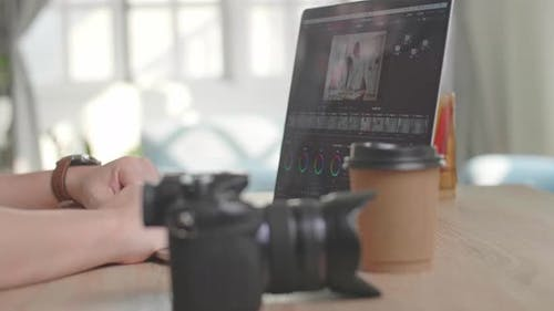 Close Up Laptop Video Cutting And Grading Color Footage